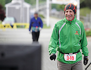 Augusta, New Jersey - Bill Gentry looks at his mileage total on a screen at the finish line during the 3 Days at the Fair races at Sussex County Fairgrounds on May 10-13 2012. He was running in the 72-hour event and finish with 189 miles.