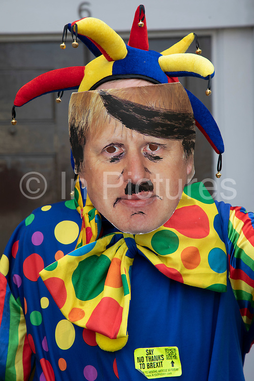 Anti Brexit protester dressed as a clown version of Boris Johnson with messages to Stop Brexit, Stop the Coup and Pro Democracy in Westminster on the day after Parliament voted to take control of Parliamentary proceedings and prior to a vote on a bill to prevent the UK leaving the EU without a deal at the end of October, on 4th September 2019 in London, England, United Kingdom. Yesterday Prime Minister Boris Johnson faced a showdown after he threatened rebel Conservative MPs who vote against him with deselection, and vowed to aim for a snap general election if MPs succeed in a bid to take control of parliamentary proceedings to allow them to discuss legislation to block a no-deal Brexit.