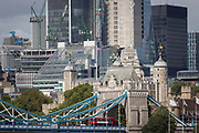 A cityscape of the City of London in the background with the northern abutment tower of Tower Bridge and the Norman-era Tower of London flying the British Union Jack flag, on 14th September 2017, in London, England.