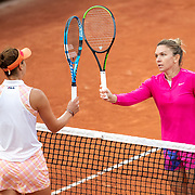 PARIS, FRANCE September 30. Simona Halep of Romania and compatriot Irina-Camelia Begu of Romania tap racquets at the net at the end of the match won by Simona Halep in the second round of the singles competition on CourtSuzanne Lenglen during the  French Open Tennis Tournament at Roland Garros on September 30th 2020 in Paris, France. (Photo by Tim Clayton/Corbis via Getty Images)