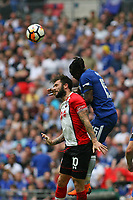 Football - 2017 / 2018 FA Cup - Semi Final: Chelsea vs. Southampton<br /> <br /> Victor Moses of Chelsea out jumps Southampton's Charlie Austin to head clear at Wembley Stadium <br /> <br /> COLORSPORT/SHAUN BOGGUST