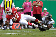 October 6, 2007 - Kansas City, MO..Running back Larry Johnson #27 of the Kansas City Chiefs gets tackled by linebacker Daryl Smith #52 of the Jacksonville Jaguars in the first quarter, during a NFL football game at Arrowhead Stadium in Kansas City, Missouri on October 6, 2007....Photo by Peter G. Aiken/Cal Sport Media