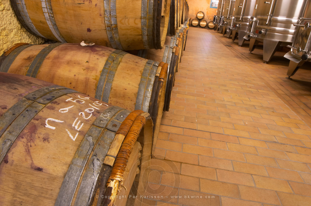 The winery with stainless steel fermentation tanks and old wooden barrels barriques with chalk inscriptions to identify the wine  Chateau Kirwan, Cantenac  Margaux  Medoc  Bordeaux Gironde Aquitaine France