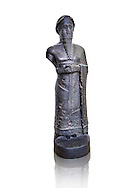 Statue of Puzur-Ishtar Shakkanakku  (military governor or prince c. 2050 BC)) of Mari appointed by the Akkad Kings. According to the inscription below the right hand above the hem of the garment , the sculpture was originally made as a votive gift. The name Puzar-Eshtar, Prince of Mari, is mentioned twice, but the figures headgear is the horned cap of a deity, the statue cannot depict the mortal prince. The clasped hands of the figure and the text make it certain that the statue once belonged to the inventory of a temple, but where the temple stood is not known, despite the mention of Mari in the title of the prince. Like many other monuments, the statue was looted from its original site in Mari and the body was was discovered in the museum of Nebuchadrezzar's palace at Babylon (604-562 BC). This oversized statue is one of the few large preserved sculptures of the Near East. The head was broken from the body in antiquity and both pieces survived separately. The excavated body was taken to the Istanbul Museum and an exchange of casts with the Pergamon Mus The Vorderasiatisches Museum, part of the head from the Pergamon Museum meant that the statue could be reassembled. The Vorderasiatisches Museum, part of the Pergamon Museum, Berlin