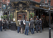 Friday evening after work drinkers outside the Salisbury pub, Strand, London, England