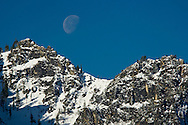 Moon set over snow covered mountain ridge above Yosemite Valley, Yosemite National Park, California