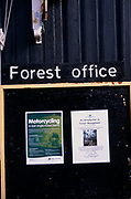 A913PE Forest office sign with two posters one about motorcycling in the forest, Rendlesham, Suffolk, England