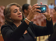 Houston ISD trustee Rhonda Skillern-Jones captures the action during a stop of the Listen & Learn tour at Black Middle School, September 20, 2016.