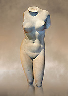 2nd century Roman marble torso copy of the statue of Aphrodite of Cnidus by Praixitele. Many Roman replicas exist of the Aphrodite of Cnidus which is one of the most famous statues of antiquity. The statue depicts the goddess bathing with a vase of water beside her. The lost original is a Hellenistic Greek sculpture made in 360-350 BC which is attributed to Athenian sculpture Praxiteles. Tradition has it that the model for the original was the lover of sculptor Phryne. The original is the oldest known female nude in Greek sculpture.  Inv Ma 2184 Louvre Museum, Paris. .<br /> <br /> If you prefer to buy from our ALAMY STOCK LIBRARY page at https://www.alamy.com/portfolio/paul-williams-funkystock/greco-roman-sculptures.html- Type -    Louvre    - into LOWER SEARCH WITHIN GALLERY box - Refine search by adding a subject, place, background colour,etc.<br /> <br /> Visit our CLASSICAL WORLD HISTORIC SITES PHOTO COLLECTIONS for more photos to download or buy as wall art prints https://funkystock.photoshelter.com/gallery-collection/The-Romans-Art-Artefacts-Antiquities-Historic-Sites-Pictures-Images/C0000r2uLJJo9_s0c