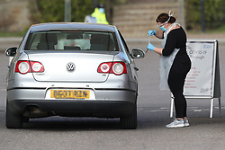 EDITORS NOTE: NUMBER PLATE PIXELATED BY PA PICTURE DESK Medical staff taking samples at 10.05am at an NHS drive through coronavirus disease (COVID-19) testing facility at Chessington World of Adventures, in Greater London, as the UK continues in lockdown to help curb the spread of the coronavirus.
