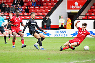 Barnsley forward Jacob Brown (33) scores the winning goal in time added on during the EFL Sky Bet League 1 match between Walsall and Barnsley at the Banks's Stadium, Walsall, England on 23 March 2019.