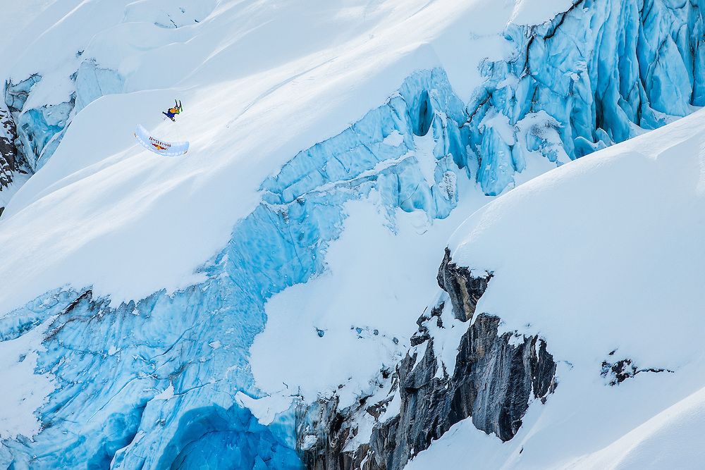 Andy Farington jumps off a large cliff into a spiraling barrel roll while filming for the Unrideables in the Tordrillo Mountains near Anchorage, Alaska on April 23rd, 2014.