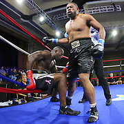 Mike Bolagun of Upper Marlboro, Maryland (R) fights Terrance Marbar of St. Pete, Florida in a heavyweight clash during a Nelsons Promotions boxing match at the Boca Raton Resort  and Club on Friday, May 26, 2017 in Boca Raton, Florida.  (Alex Menendez via AP)