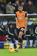 Hull City midfielder Ahmed Elmohamady (27) looking for someone to pass to  during the Sky Bet Championship match between Hull City and Cardiff City at the KC Stadium, Kingston upon Hull, England on 13 January 2016. Photo by Ian Lyall.