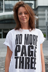 "© Licensed to London News Pictures. 13/10/2012. London, UK. Lucy Anne Holmes outside the News International offices in Wapping after delivering a letter to Dominic Mohan, editor of The Sun newspaper demanding an end to topless models on Page 3. An online petition started by Lucy Holmes is campaigning to ""Take the bare boobs out of The Sun"". Photo credit : Vickie Flores/LNP"