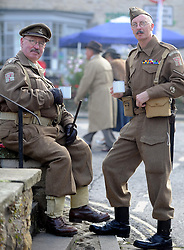 © Licensed to London News Pictures. 12/10/2014. Pickering, UK The annual wartime weekend in Pickering, North Yorkshire. People dress in 1940s period themed outfits and attend parades through the small Yorkshire town which has a traditional steam railway as would have been used in the 1940s. // Pictured: (l-r) Peter Taylor and Colin Taylor with their Dad's Army themed outfits. Photo credit :  HARRY ATKINSON/LNP