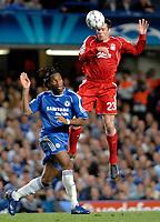 Photo: Richard Lane.<br />Chelsea v Liverpool. UEFA Champions League. Semi Final, 1st Leg. 25/04/2007. <br />Liverpool's  Jamie Carragher beats Chelsea's Didier Drogba to the ball.