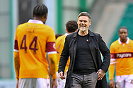Motherwell FC manager Graham Alexander congratulates goalscorer Devante Cole (#44) of Motherwell FC after the final whistle of the SPFL Premiership match between Hibernian FC and Motherwell FC at Easter Road, Edinburgh, Scotland on 27 February 2021.