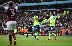 Derby County's Cameron Jerome celebrates scoring  the opening goal after error by Aston Villa's Neil Taylor