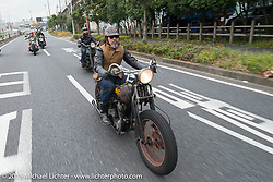 """""""Sushi"""" Atsushi Yasui leads a ride around Tokyo with friends of the Freewheelers And Company shop. Tokyo, Japan. December 8, 2015.  Photography ©2015 Michael Lichter."""