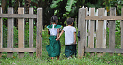 two children walk away from camera hand in hand Photographed in Myanmar, Hsipaw