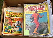 Close up of old comic magazines in box at car boot sale, Suffolk, England, UK