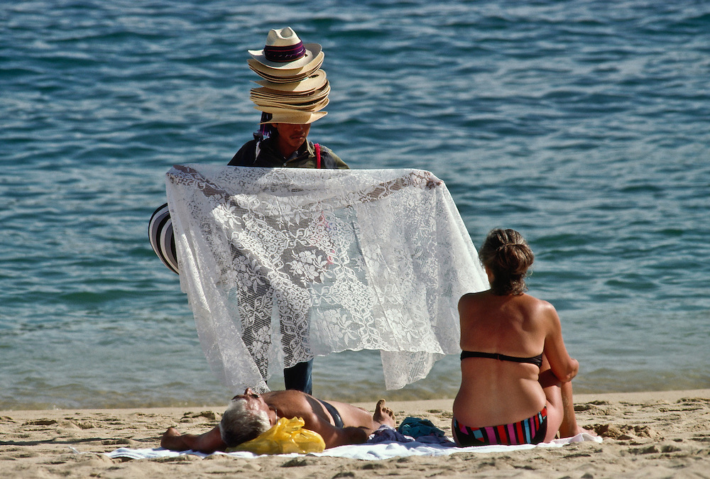 A vendor selling his wares on the beach in Baja California.