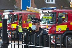 © Licensed to London News Pictures 02/02/2021.        Maidstone, UK. Fire Engines at Kent Police HQ meeting point. Door to door testing for the South African variant of Covid-19 has started in the Maidstone area of Kent this afternoon. Police, Fire and NHS staff along with volunteers from Kent Search and Rescue and Kent County Council are handing out PCR tests to residents than collecting them an hour later. Photo credit:Grant Falvey/LNP