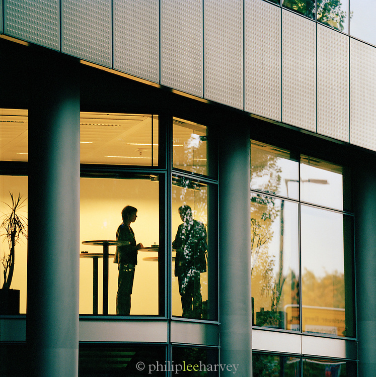 Office workers in discussion, Berlin, Germany