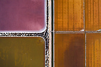 Aerial view of geometric and colourful salines near Cagliari, Italy.