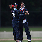 Katherine Brunt is congratulated by team mate Isa Guha after taking a wicket during the match between England and New Zealand in the Super 6 stage of the ICC Women's World Cup Cricket tournament at Bankstown Oval, Sydney, Australia on March 14 2009, England won the match by 31 runs. Photo Tim Clayton
