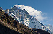 Lhotse (27,923 feet / 8511 meters, above sea level) is the world's fourth highest peak. The tremendous south face of Lhotse rises 2 vertical miles in a steep slope averaging a 55 degree angle. Over 50 million years, global tectonic forces drove India against Asia, lifting these former sea bed layers to the top of the world. The Himalaya are still rising 2 inches every year. Sagarmatha National Park was created in 1976 and honored as a UNESCO World Heritage Site in 1979.