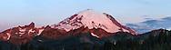 Alpenglow on Mount Rainier at Sunrise from Tipsoo Lake in Mount Rainier National Park, Washington State, USA