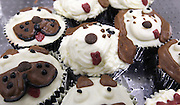 """These organic, dog-friendly """"pupcakes"""" are iced to resemble the faces of a variety of dog breeds."""
