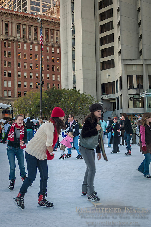 Ice skaters Skating in the Holiday Ice Rink, Justin Herman Plaza on the Embarcadero, downtown San Francisco, California