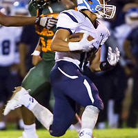 The Fighting Scouts running back Cobren Nez, right, races to the outside of the Bears defense for a short gain. Window Rock High School faced off against Wingate High School at home in Fort Wingate, NM.