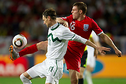 Milivoje Novakovic of Slovenia vs James Milner of England during the 2010 FIFA World Cup South Africa Group C Third Round match between Slovenia and England on June 23, 2010 at Nelson Mandela Bay Stadium, Port Elizabeth, South Africa.  (Photo by Vid Ponikvar / Sportida)