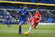 Sean Morrison of Cardiff city (l) gets to the ball ahead of Rudy Gestede of Middlesbrough.EFL Skybet championship match, Cardiff city v Middlesbrough at the Cardiff city Stadium in Cardiff, South Wales on Saturday 17th February 2018.<br /> pic by Andrew Orchard, Andrew Orchard sports photography.