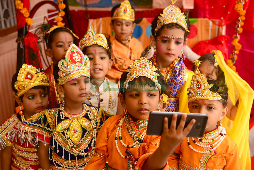 August 14, 2017 - Ajmer, Rajasthan, India - Janamashtami celebartion in Ajmer,Rajasthan,India,on 14 august 2017,photo by shaukat ahmed.Children dressed as Lord Krishna  in a religious procession on the occasion on the eve of Janamashtami on 13 august 2017, in Ajmer,Rajasthan,India (Credit Image: © Shaukat Ahmed/Pacific Press via ZUMA Wire)