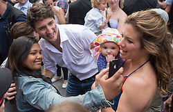 Prime Minister Justin Trudeau and his wife Sophie Gregoire Trudeau (right)stop for a photo at a street party for the Fete National du Quebec, Saturday, June 24, 2017 in Montreal, Canada. Photo by Paul Chiasson/CP/ABACAPRESS.COM