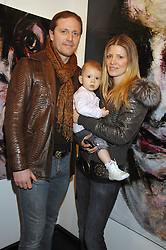 MR & MRS EMANUEL PETIT, he is the footballer and their daughter VIOLET at a private view of paintings by Lita Cabellut and Russian artist Yuri Kuper at Opera Gallery, 134 New Bond Street, London on 2nd April 2008.<br /><br />NON EXCLUSIVE - WORLD RIGHTS