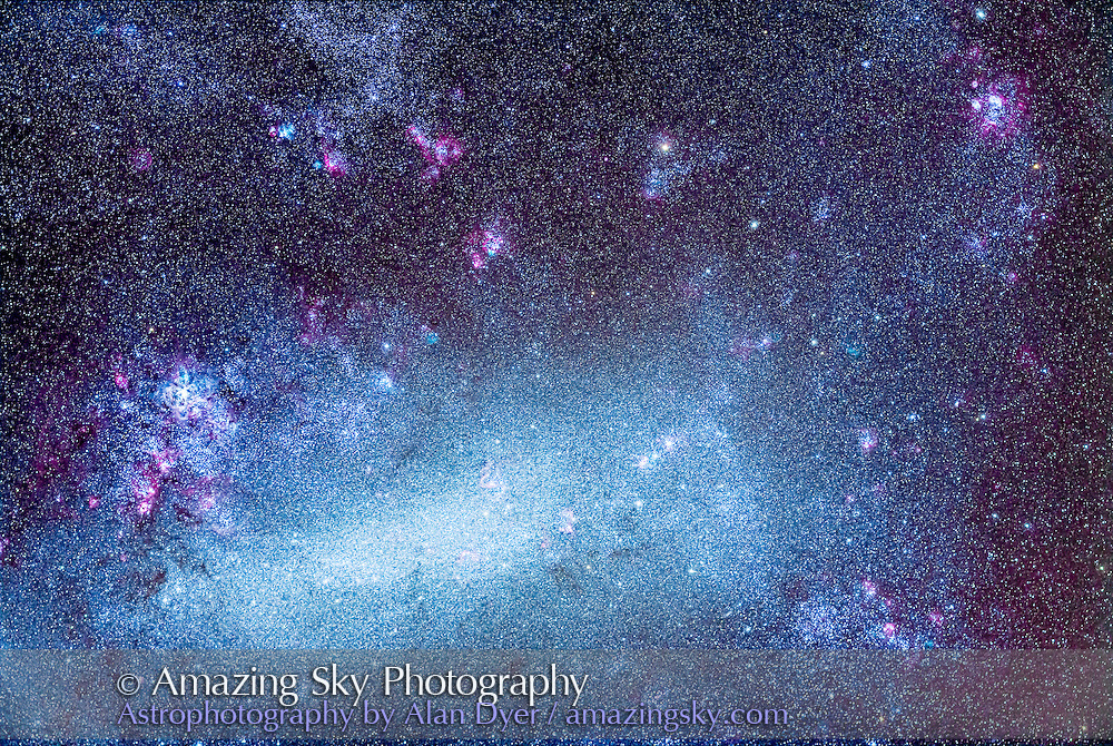 The Large Magellanic Cloud (LMC), an irregular satellite galaxy of the Milky Way, and one of the prime attractions of the southern hemisphere sky. At left is the Tarantula Nebula, NGC 2070, while at upper right is the second brightest nebula in the LMC, NGC 1763, aka the LMC Lagoon. In between are an amazing number of nebulas, both magenta and cyan in tint, as well as clusters of stars. The LMC is 160,000 light years away, and is gravitationally bound to the Milky Way, though there is some dispute whether it is orbiting the Milky Way or is passing by.<br /> <br /> This field is 6° x 4°, which just encompasses the majority of the LMC's structure and features. <br /> <br /> I shot this Monday, March 24, 2014 from the Warrumbungles Mountain Motel grounds, near Coonabarabran, NSW, Australia. This is a stack of 6 x 10 minute exposures with the Borg 77mm aperture astrographic lens, a 300mm f/4 system, and the Canon 5D MkII camera, filter modified by Hutech, at ISO 800. Shots had to dodge clouds moving through during the evening. Humidity was high from rain earlier in the day. But transparency was good when skies were clear.