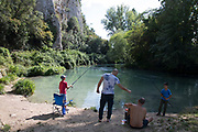 Family fishing on the River Nera at Arrone, Umbria, Italy.