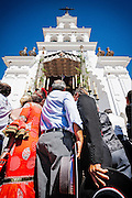 The Brotherhood of Barcelona makes their presentation at the hermitage, several pilgrims hold the carriage while the event takes place