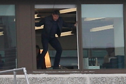 Tom Cruise appears to trip and hurt his leg as he jumps out of a high window on the set of Mission Impossible 6 in London. The daredevil actor was seen limping as aides rushed to help. It has been reported Tom was later seen on crutches. Filming was delayed for months after Tom injured his leg performing a similar stunt last August. 13 Jan 2018 Pictured: Tom Cruise. Photo credit: MEGA TheMegaAgency.com +1 888 505 6342