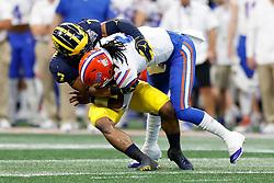 Florida Gators quarterback Emory Jones #5 is tackled by Michigan Wolverines linebacker Khaleke Hudson #7 during the Chick-fil-A Peach Bowl, Saturday, December 29, 2018, in Atlanta. ( Paul Abell via Abell Images for Chick-fil-A Peach Bowl)