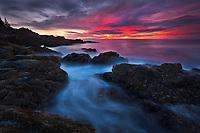 Dramatic sunrise light along the rocky coastline of Acadia National Park, Maine