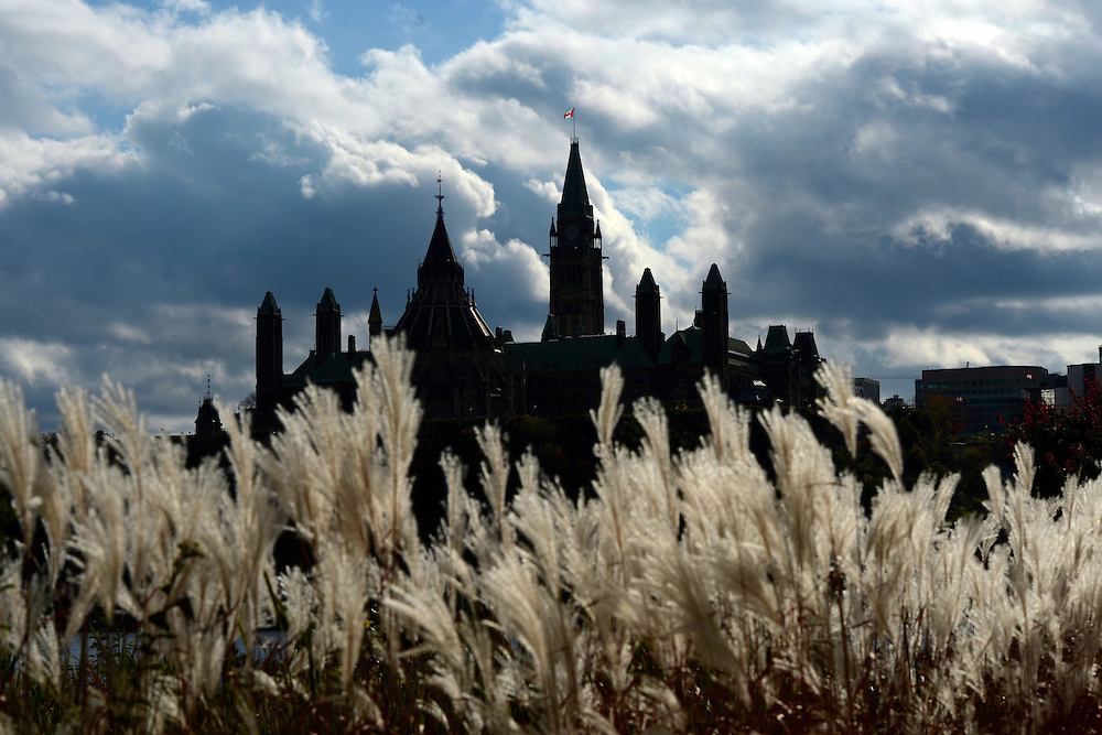 Parliament Hill in Ottawa is viewed from the shores of Gatineau, Quebec on Oct. 22, 2013. Like kids going to their first day at school, MPs will be donning their best suits and lugging freshly-filled briefcases back to work today on Parliament Hill for their last fall sitting before the next general election. THE CANADIAN PRESS/Sean Kilpatrick