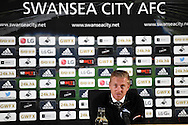Post match press conference as Swansea city manager Garry Monk learns the news that his ex manager and friend Brendan Rodgers has been sacked by Liverpool.  Barclays premier league match, Swansea city v Tottenham Hotspur at the Liberty Stadium in Swansea, South Wales on Sunday 4th October 2015.<br /> pic by  Andrew Orchard, Andrew Orchard sports photography.