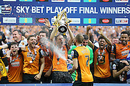 Michael Dawson  of Hull City lifts the Sky Bet Championship Playoff Trophy with his teammates as they celebrate .Skybet football league Championship play off final match, Hull city v Sheffield Wednesday at Wembley Stadium in London on Saturday 28th May 2016.<br /> pic by John Patrick Fletcher, Andrew Orchard sports photography.